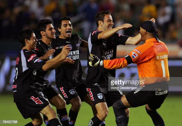 Edy Brambila Rafael Marquez Lugo Jaime Correa and Luis Gabriel Rey of Pachuca celebrate with goalkeeper Miguel Calero of Pachuca after they defeated...