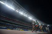 Edyta Indeka Sylwia of Poland Gabriela Andrees Doroftei of Romania and Francine Niyomwungere of Burundi runs in the women's 1500m qualifying round on...
