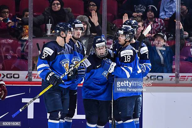 Eeli Tolvanen of Team Finland celebrates his first period goal with teammates during the 2017 IIHF World Junior Championship relegation game against...