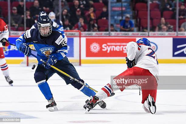 Eeli Tolvanen of Team Finland plays the puck past Filip Hronek of Team Czech Republic during the IIHF World Junior Championship preliminary round...