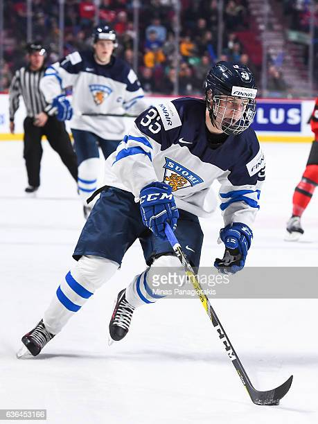 Eeli Tolvanen of Team Finland skates the puck during the IIHF exhibition game against Team Canada at the Bell Centre on December 19 2016 in Montreal...
