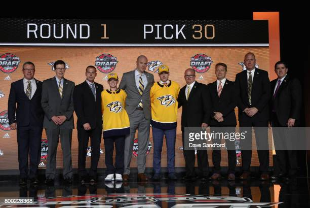 Eeli Tolvanen poses onstage with team personnel after being selected 30th overall by the Nashville Predators during Round One of the 2017 NHL Draft...