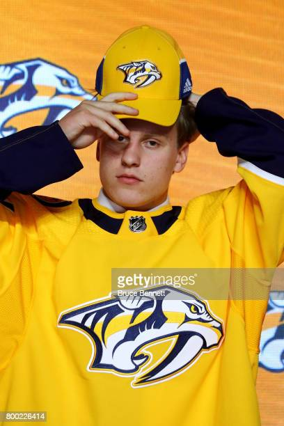 Eeli Tolvanen puts on the Nashville Predators after being selected 30th overall during the 2017 NHL Draft at the United Center on June 23 2017 in...