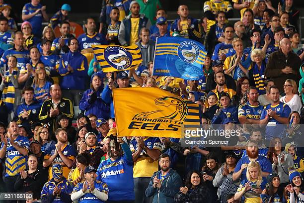 Eels fans stand and applaud during the ninth minute of the match during the round 10 NRL match between the Parramatta Eels and the South Sydney...