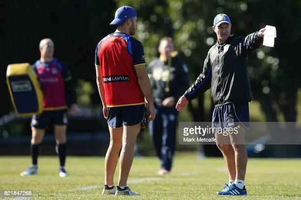 Eels head coach Brad Arthur talks to Corey Norman during a Parramatta Eels NRL training session at on July 25 2017 in Sydney Australia