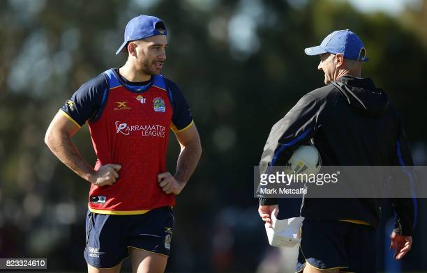 Eels head coach Brad Arthur talks to Corey Norman during a Parramatta Eels NRL training session at on July 25 2017 in Sydney Australia