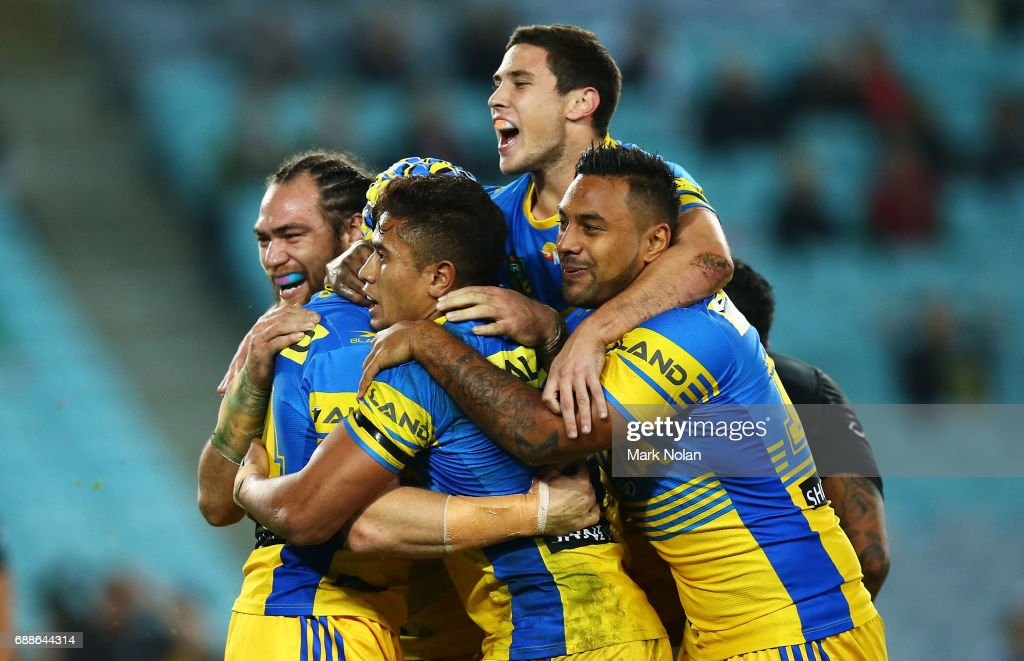 Eels players celebrate a try by Beau Scott of the Eels during the round 12 NRL match between the South Sydney Rabbitohs and the Parramatta Eels at ANZ Stadium on May 26, 2017 in Sydney, Australia.