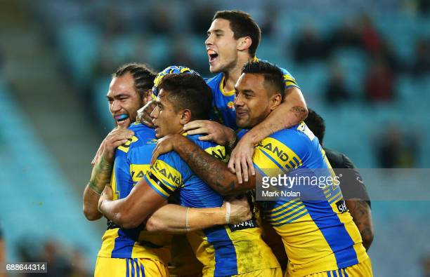 Eels players celebrate a try by Beau Scott of the Eels during the round 12 NRL match between the South Sydney Rabbitohs and the Parramatta Eels at...