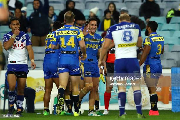 Eels players celebrate a try scored by Bevan French during the round 17 NRL match between the Parramatta Eels and the Canterbury Bulldogs at ANZ...