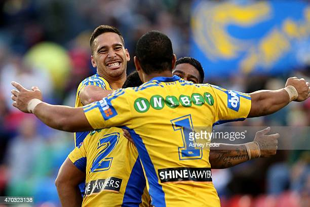 Eels players Nathan Peats Isaac De Gois Chris Sandow and Will Hopoate celebrate a try during the round seven NRL match between the Newcastle Knights...