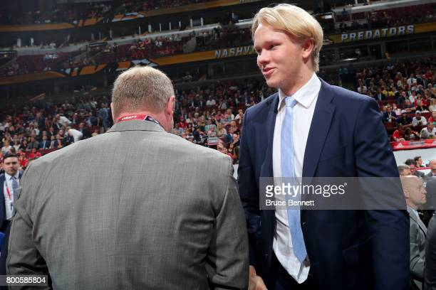 Eemeli Rasanen meets with executives after being selected 59th overall by the Toronto Maple Leafs during the 2017 NHL Draft at the United Center on...