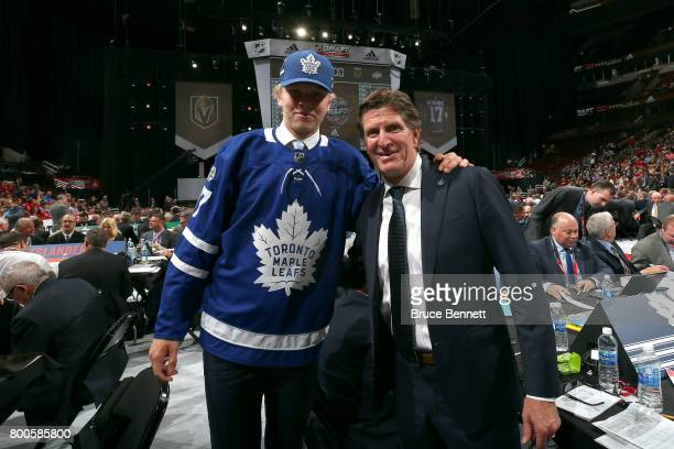 Eemeli Rasanen poses for a photo with coach Mike Babcock after being selected 59th overall by the Toronto Maple Leafs during the 2017 NHL Draft at...