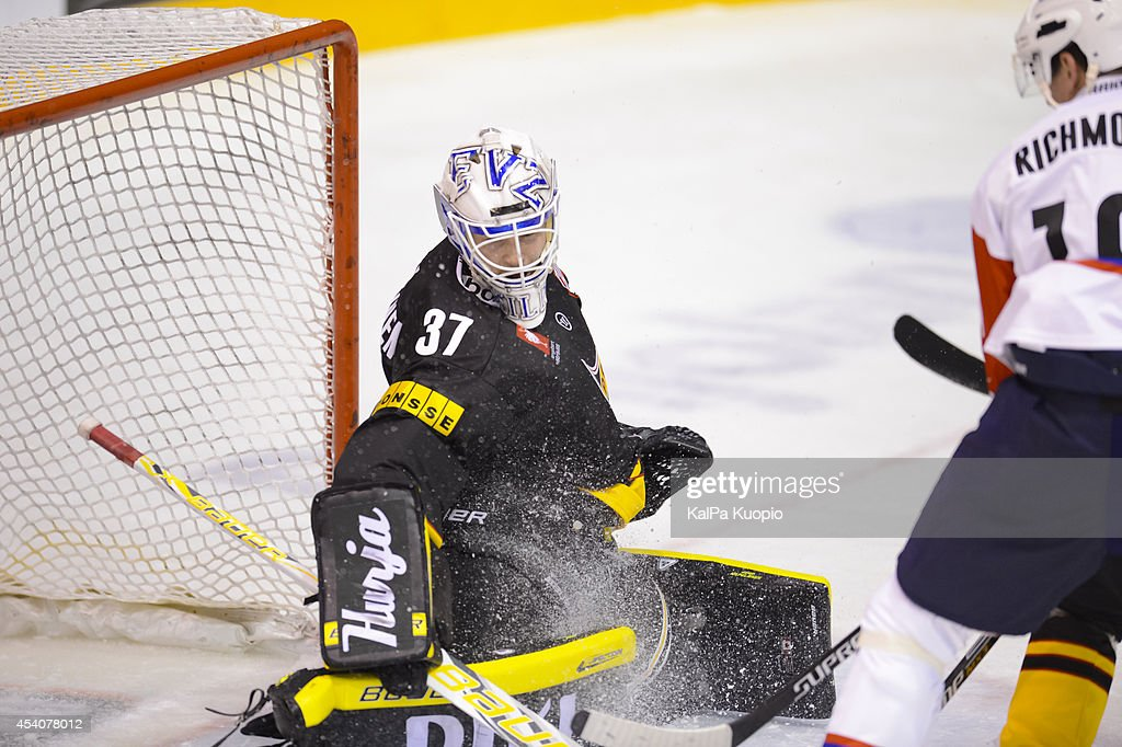 Eero Kilpeläinen #37 saves the goal by last minute during the Champions Hockey League group stage game between KalPa Kuopio and Adler Mannheim on August 24, 2014 in in Kuopio, Finland.