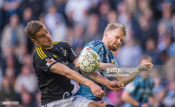 Eero Markkanen of AIK and Jacob Une Larsson of Djurgardens IF during the Allsvenskan match between Djurgardens IF and AIK at Tele2 Arena on May 22...