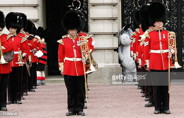 Eeyore watches the guards on the Forecourt of Buckingham Palace for the Queen's 80th Birthday Children's Garden Party on June 25 2006 in London