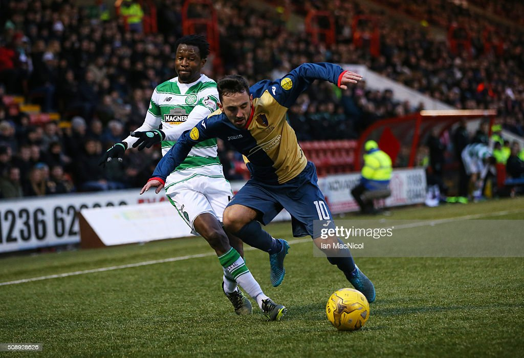 <a gi-track='captionPersonalityLinkClicked' href=/galleries/search?phrase=Efe+Ambrose&family=editorial&specificpeople=4406353 ng-click='$event.stopPropagation()'>Efe Ambrose</a> of Celtic vies with Anthony Brady of East Kilbride during the William Hill Scottish Cup Fifth Round match between East Kilbride and Celtic at Excelsior Stadium on February 7, 2016 in Airdrie, Scotland.