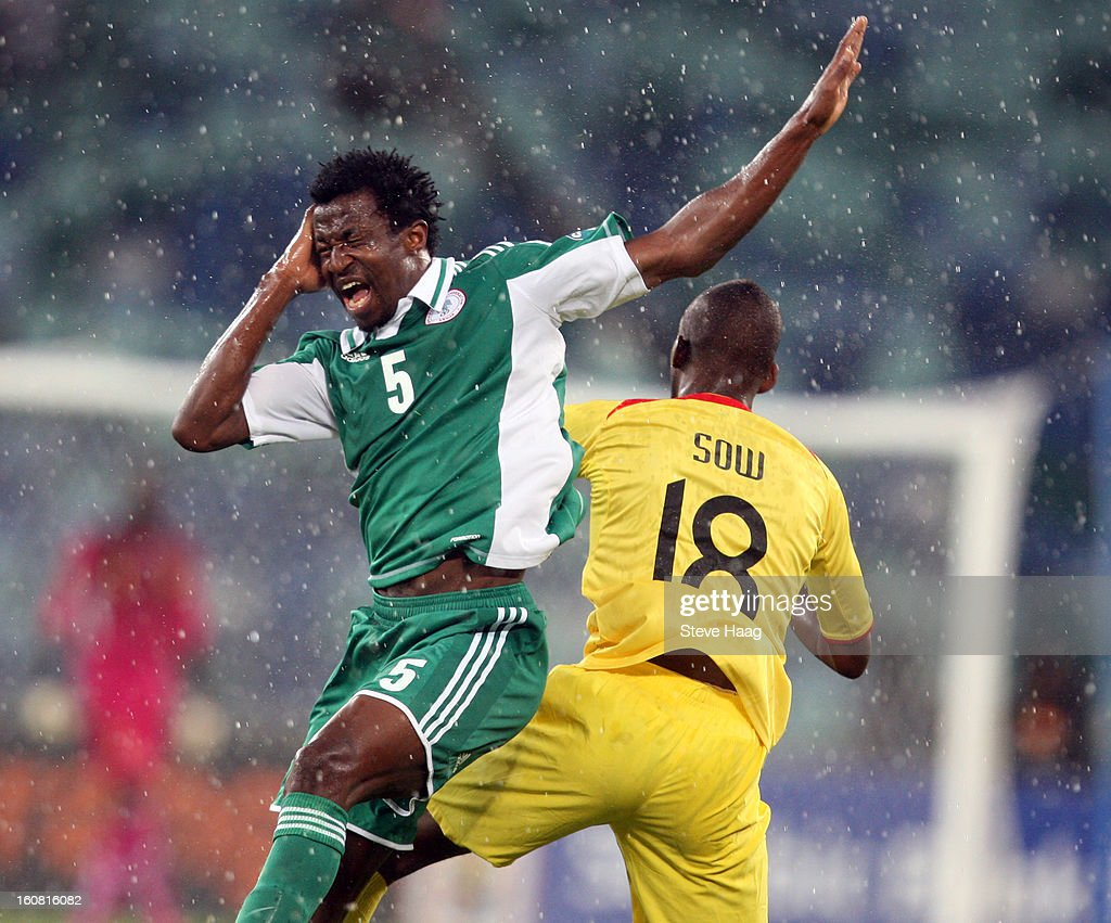 Efe Ambrose of Nigeria is hit in the head by Samba Sow of Mali during the 2013 African Cup of Nations Semi-Final match between Mali and Nigeria at Moses Mahbida Stadium on February 06, 2013 in Durban, South Africa.