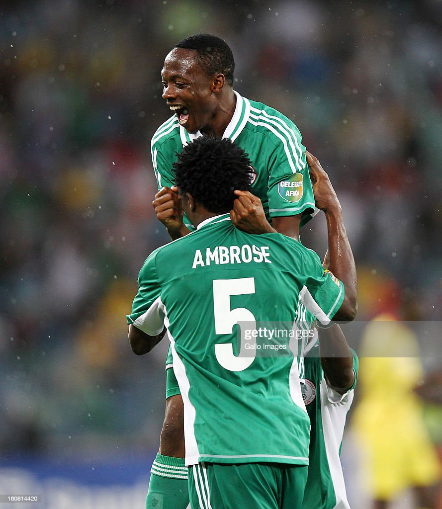 Efe Ambrose of Nigeria lifts Ahmed Musa of Nigeria during the 2013 Orange African Cup of Nations 1st Semi Final match between Mali and Nigeria at Moses Mabhida Stadium on February 06, 2013 in Durban, South Africa.