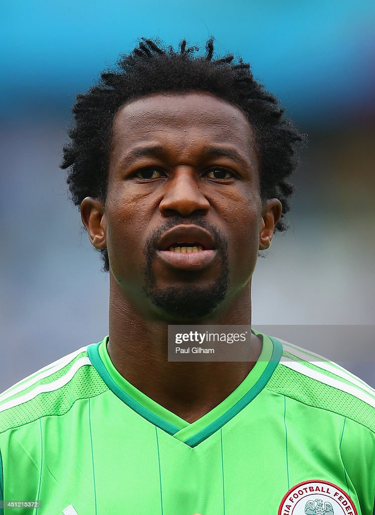 <a gi-track='captionPersonalityLinkClicked' href=/galleries/search?phrase=Efe+Ambrose&family=editorial&specificpeople=4406353 ng-click='$event.stopPropagation()'>Efe Ambrose</a> of Nigeria looks on during the National Anthem prior to the 2014 FIFA World Cup Brazil Group F match between Nigeria and Argentina at Estadio Beira-Rio on June 25, 2014 in Porto Alegre, Brazil.