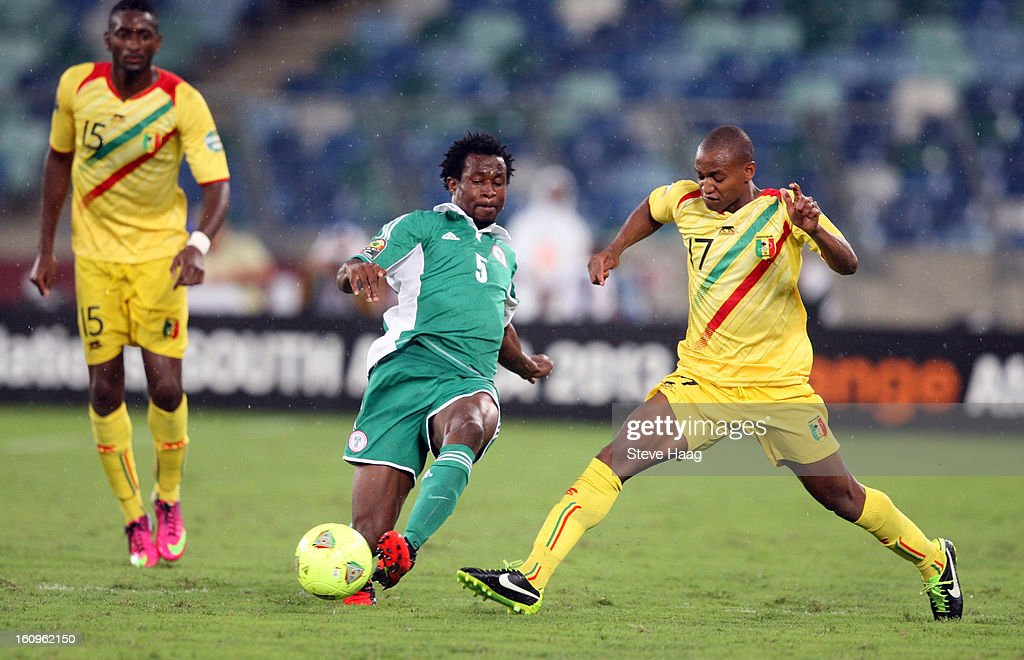 Efe Ambrose of Nigeria with a tackle on Abdrahamane Traore of Mali during the 2013 African Cup of Nations Semi-Final match between Mali and Nigeria at Moses Mahbida Stadium on February 06, 2013 in Durban, South Africa.