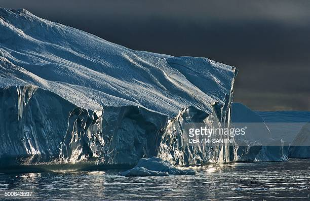 Effect of light on an iceberg detached from Jakobshavn glacier Ilulissat village Qaasuitsup west Greenland Denmark