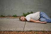 Shot of a young man passed out in the streethttp://195.154.178.81/DATA/i_collage/pu/shoots/806165.jpg