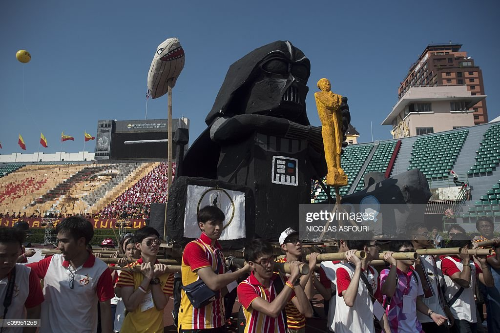 Effigies including one in the likeness of Darth Vader is seen as Thai university students participate in a parade lampooning the military junta during a varsity football match at the National stadium in Bangkok on February 13, 2016. Thai university students lampooned the military at a varsity football game in a rare act of open defiance against the junta that has strangled political expression since toppling an elected government two years ago. AFP PHOTO / Nicolas ASFOURI / AFP / NICOLAS ASFOURI