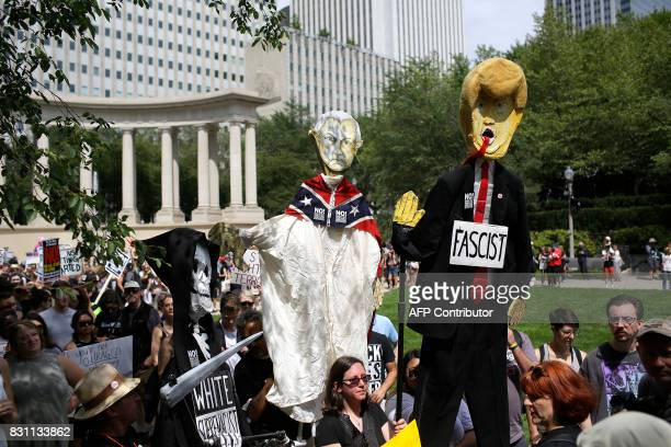 Effigies of a skeleton President Donald Trump and Attorney General Jeff Sessions are displayed as demonstrators protest against hate white supremacy...