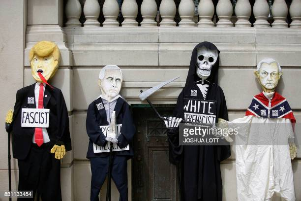 TOPSHOT A effigy of President Donald Trump Vice President Mike Pence a skeleton and Attorney General Jeff Sessions are displayed as demonstrators...