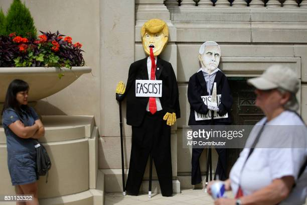 A effigy of US President Donald Trump and US Vice President Mike Pence are displayed on a wall as demonstrators protest against hate white supremacy...