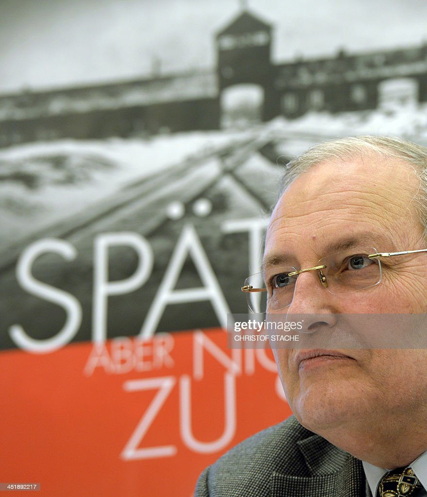 Efraim Zuroff, director of the Jerusalem Office of the Simon Wiesenthal Center, gives a news conference on the center's initiative 'Operation last chance - late but not too late' in Munich, southern Germany, on November 25, 2013. Efraim Zuroff launched the 'Operation Last Chance II', a campaign to bring individuals to justice who were involved in the mass murder of Jews during the Holocaust. With 2,500 placards in the German cities of Munich, Leipzig, Dresden, Magdeburg, Rostock, Stuttgart, Nuremberg and Frankfurt, the Simon Wiesenthal Center re-launched the campaign to find and prosecute Nazi war criminals who are still alive. AFP PHOTO / CHRISTOF STACHE