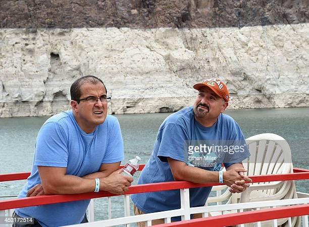 Efrain Contreras and Ted Gonzalez both of Texas pass in front of a mineralstained rock wall as they take a bout tour on July 14 2014 in the Lake Mead...