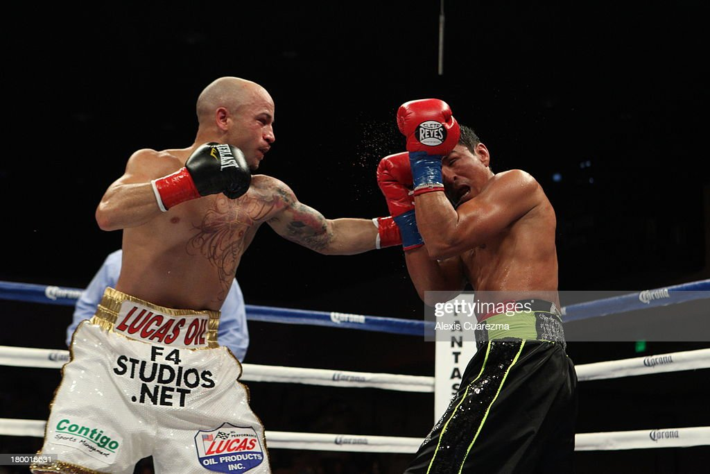 Efrain Esquivias (L) lands a left on Rafael Marquez (R) during their fight as the main co-event at the Fantasy Springs Resort Casino - Special Events Center on September 7, 2013 in Indio, California.