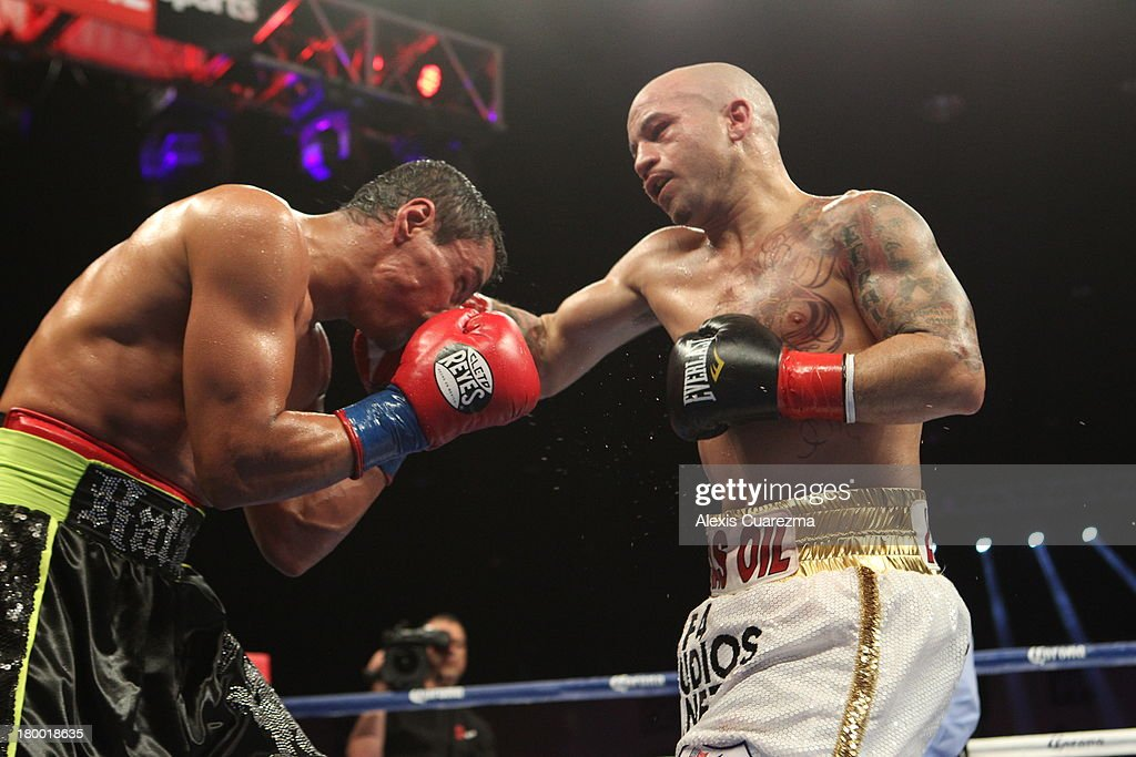 Efrain Esquivias (R) lands a right on Rafael Marquez (L) during their fight as the main co-event at the Fantasy Springs Resort Casino - Special Events Center on September 7, 2013 in Indio, California.
