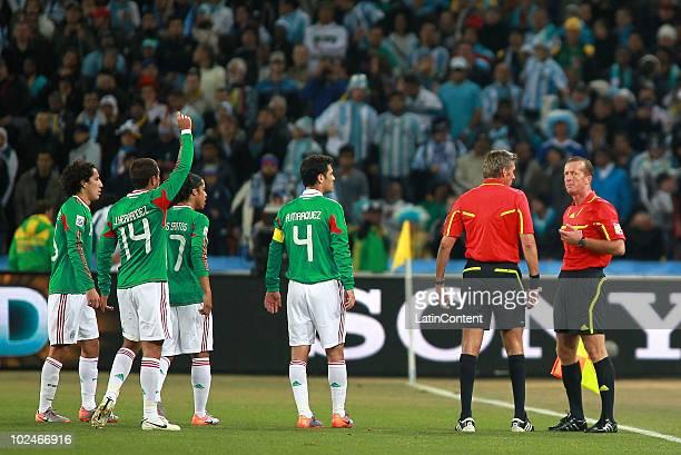 Efrain Juarez Javier Hernandez Giovani dos Santos and Rafael Marquez of Mexico complain to the referee Roberto Rosetti and referee assistant Stefano...