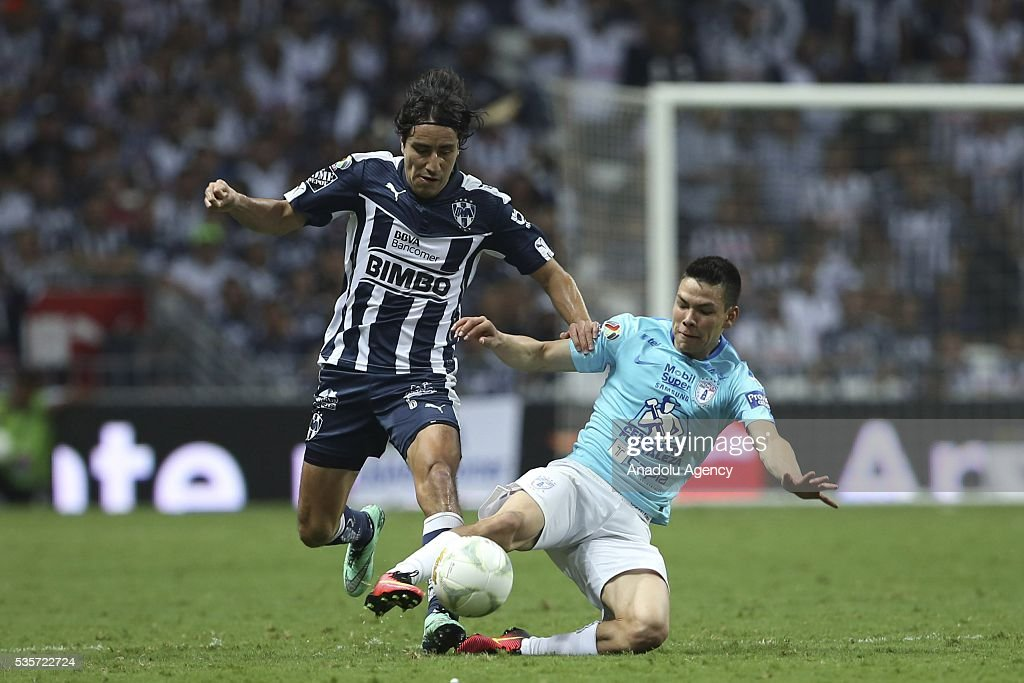 Efrain Juarez (L) of Monterrey in action against Hirving Lozano (R) of Pachuca during the Final second leg match of the Clausura 2016 Liga MX between Monterrey and Pachuca, at BBVA Bancomer Stadium, in Monterrey, Mexico on May 29, 2016.