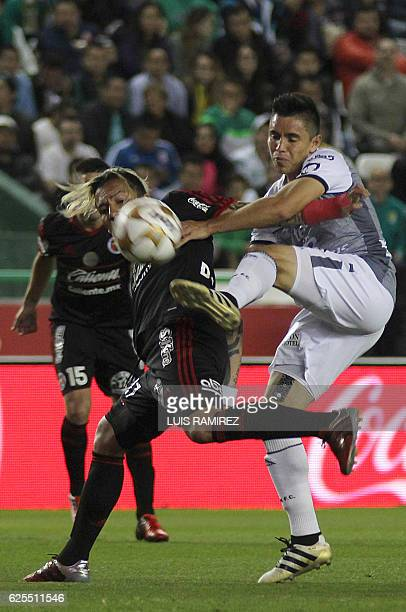 Efrain Velarde of Leon vies for the ball with Tijuana's Dayro Moreno during their Mexican Apertura 2016 Tournament quarterfinal match at Nou Camp...