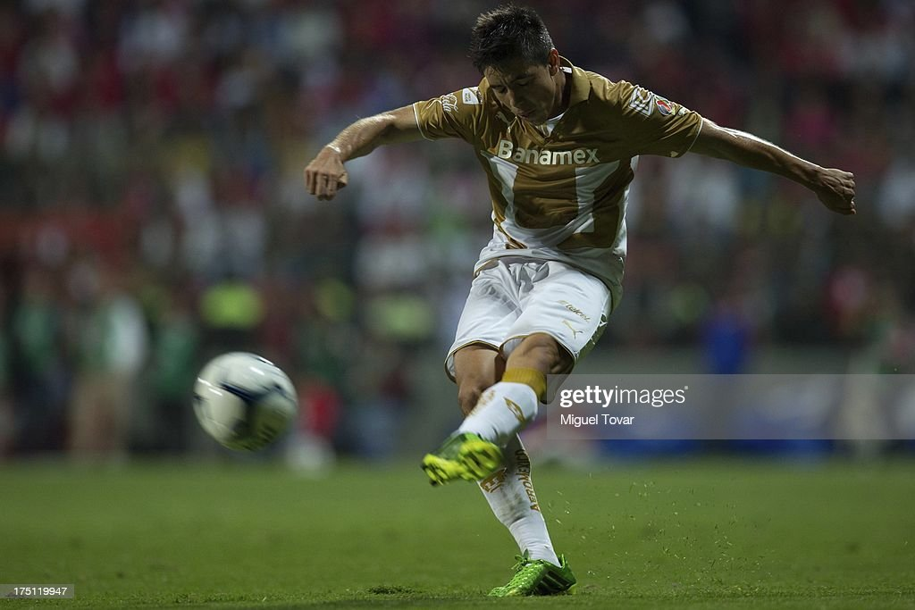 Efrain Velarde of Pumas kicks the ball during a match between Toluca and Pumas as part of the Torneo Apertura 2013 Liga MX at Nemesio Siez stadium, on July 31, 2013 in Toluca, Mexico.