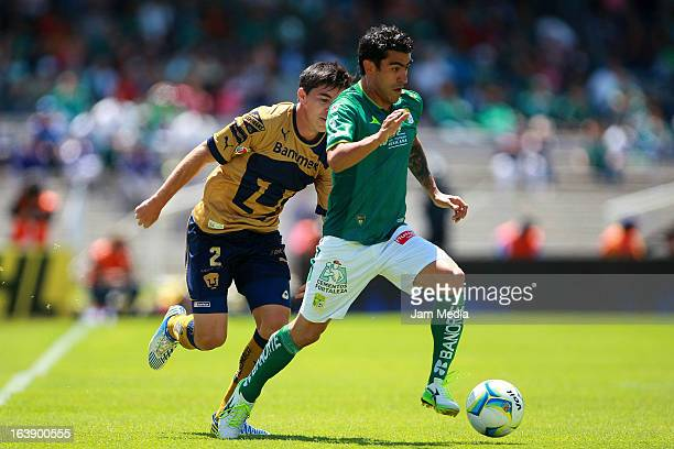 Efrain Velarde of Pumas struggles for the ball with Nery Castillo of Leon during a match between Santos and Leon as part of Clausura 2013 Liga MX at...