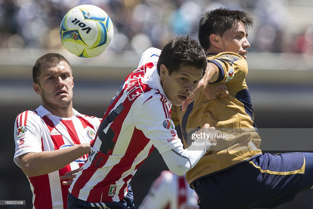 Efrain Velarde (R) of Pumas struggles for the ball with Sergio Perez (L) of Chivas during a match between Pumas and Chivas as part of Clausura 2013 Liga MX at Olympic Stadium on March 03, 2013 in Mexico City, Mexico.