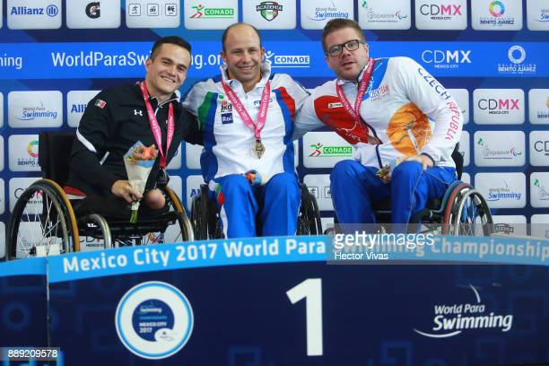 Efrem Morelli of Italy Gold Medal States Gustavo Sánchez of Mexico Silver Medal and Jan Povysil of Poland Bronze Medal pose after men's 150 m...
