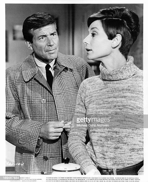 Efrem Zimbalist Jr listens to Audrey Hepburn in a scene from the film 'Wait Until Dark' 1967