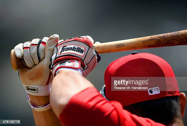 Efren Navarro of the Los Angeles Angels of Anaheim wearing Franklin batting gloves holds on to his bat during batting practice prior to playing the...