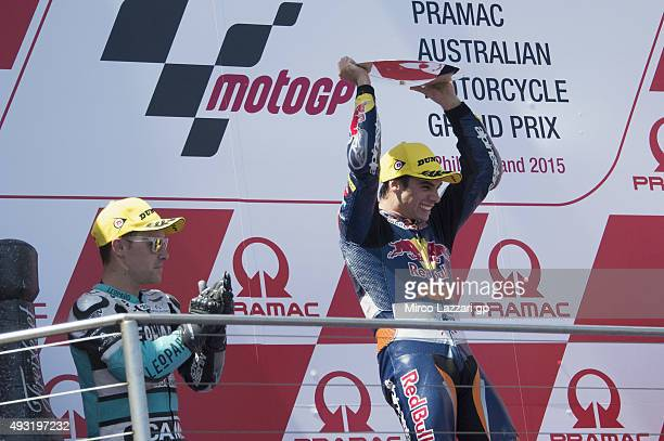 Efren Vazquez of Spain and Leopard Racing Miguel Oliveira of Portugal and Red Bull KTM Ajo celebrate on the podium at the end of the Moto3 race...