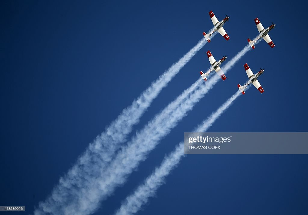 Efroni T6 Texan II planes perform during an air show as part of a graduation ceremony of Israeli pilots at the Hatzerim air force base in the...