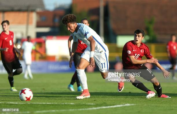Egehan Gok of Turkey in action against Jadon Sancho of England during the UEFA European Under17 Championship soccer match between Turkey and England...