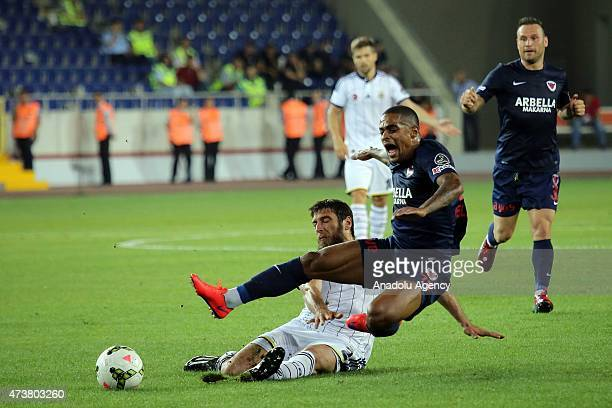 Egemen Korkmaz of Fenerbahce vies for the ball with Gokcek Vederson of Mersin Idmanyurdu during the Turkish Spor Toto Super League football match...