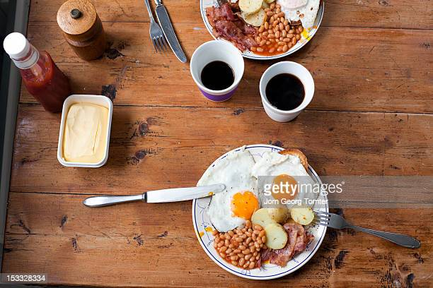 Egg, bacon and beans breakfast on wooden table