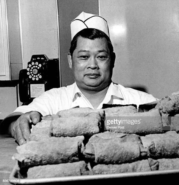 Egg Rolls to Be PTA Fare Danny Wong owner of Plain View Inn 3380 W 38th Ave is shown with a plate of egg rolls of the sort that he has donated to PTA...