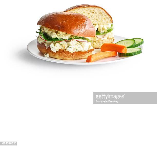 Egg salad sandwich with lemon and radishes